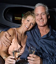 Brampton Restorative Dentistry Older couple holding champagne smiling